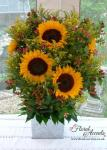Small pedestal design of sunflowers, hypericum berries and solidago